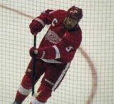 Johan Franzen takes a shot on net during pre-game warmups, wearing Nicklas Lidstrom's jersey in honor of its retirement.