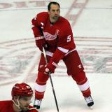 David Legwand skates at center ice during pre-game warmups, wearing Nicklas Lidstrom's jersey in honor of its retirement.