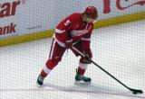Justin Abdelkader tees up a shot during pre-game warmups, wearing Nicklas Lidstrom's jersey in honor of its retirement.