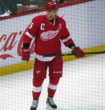 Tomas Jurco stands near the boards during pre-game warmups, wearing Nicklas Lidstrom's jersey in honor of its retirement.