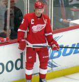 Brendan Smith stands along the boards during pre-game warmups, wearing Nicklas Lidstrom's jersey in honor of its retirement.