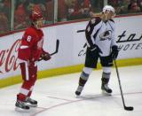 Justin Abdelkader and Colorado's Tyson Barrie get set for a faceoff.