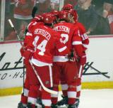Todd Bertuzzi, Jonathan Ericsson, Joakim Andersson, Drew Miller and Niklas Kronwall celebrate a goal by Kronwall.