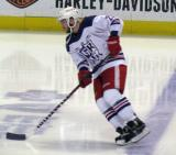 Landon Ferraro skates across the blue line during pre-game warmups before the Grand Rapids Griffins' Purple Game.