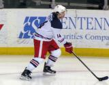 Nick Jensen carries a puck along the boards during pre-game warmups before the Grand Rapids Griffins' Purple Game.
