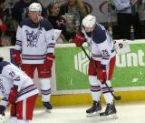 Nathan Paetsch and Louis-Marc Aubry stand along the boards in front of the bench during pre-game warmups before the Grand Rapids Griffins' Purple Game.