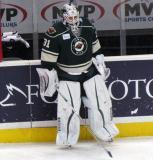 Johan Gustafsson of the Iowa Wild stands along the boards during pre-game warmups before a game against the Grand Rapids Griffins.