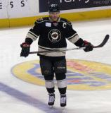 Jake Dowell of the Iowa Wild skates at the blue line during pre-game warmups before a game against the Grand Rapids Griffins.