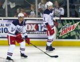 Jeff Hoggan and Adam Almquist skate near the boards during pre-game warmups before the Grand Rapids Griffins' Purple Game.