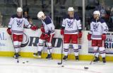Cory Emmerton, Andrej Nestrasil, Brennan Evans and Landon Ferraro stand along the boards during pre-game warmups before the Grand Rapids Griffins' Purple Game.