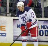 Jordin Tootoo stands along the boards during pre-game warmups before the Grand Rapids Griffins' Purple Game.