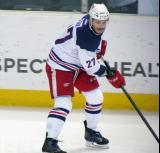 Martin Frk carries a puck along the boards during pre-game warmups before the Grand Rapids Griffins' Purple Game.