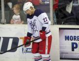 Jordin Tootoo stands at the boards during pre-game warmups before the Grand Rapids Griffins' Purple Game.