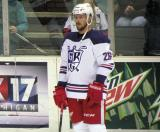 David McIntyre stands at the boards during pre-game warmups before the Grand Rapids Griffins' Purple Game.