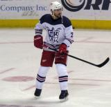 David McIntyre skates through a faceoff circle during pre-game warmups before the Grand Rapids Griffins' Purple Game.