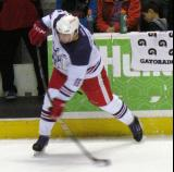 Xavier Ouellet fires a shot during pre-game warmups before the Grand Rapids Griffins' Purple Game.