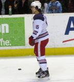 Mitch Callahan stands near the boards during pre-game warmups before the Grand Rapids Griffins' Purple Game.