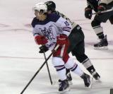 Mitch Callahan fights off an Iowa Wild player during the Grand Rapids Griffins' Purple Game.