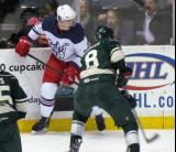 Louis-Marc Aubry battles for the puck with Kyle Medvec of the Iowa Wild during the Grand Rapids Griffins' Purple Game.
