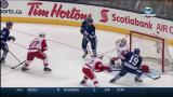 Jimmy Howard makes a pad stop on Toronto's Joffrey Lupul off a chance from in close.