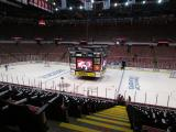 The Joe Louis Arena scoreboard is lowered to center ice to get worked on before a playoff game against the Boston Bruins.