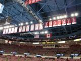 The banners for the Red Wings' Stanley Cup Championships and the team's retired jersey numbers hanging in Joe Louis Arena.
