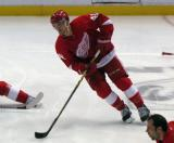 Luke Glendening skates in the neutral zone during pre-game warmups.