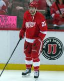 Brian Lashoff stands along the boards during pre-game warmups.