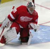 Jimmy Howard gloves a puck during pre-game warmups.