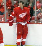 David Legwand stands at the boards, laughing, during pre-game warmups.