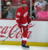 Drew Miller skates along the boards during pre-game warmups.