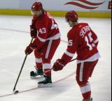 Darren Helm and Riley Sheahan skate during pre-game warmups.