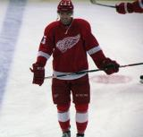 Riley Sheahan laughs while skating along the blue line during pre-game warmups.