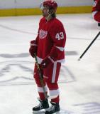 Darren Helm stands near center ice during pre-game warmups.