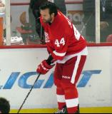 Todd Bertuzzi plays with a puck along the boards during pre-game warmups.