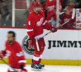 Jakub Kindl skates along the boards during pre-game warmups.
