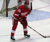 Drew Miller laughs while looking to pass the puck during pre-game warmups.