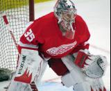 Jimmy Howard gets set to face a shot during pre-game warmups.