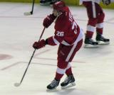 Tomas Jurco recoils from taking a shot during pre-game warmups.