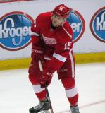 Riley Sheahan gets set to take a shot from a low angle during pre-game warmups.