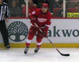 Riley Sheahan looks to receive a pass along the boards.