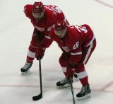 Brian Lashoff and Tomas Jurco get set for a faceoff.