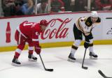 Luke Glendening and Boston's Dougie Hamilton line up for a faceoff.