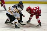 Riley Sheahan gets set to take a faceoff against Boston's Patrice Bergeron.