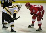 Riley Sheahan faces off against Boston's Patrice Bergeron.