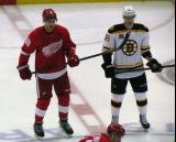 Joakim Andersson lines up at wing for a faceoff next to Reilly Smith of the Boston Bruins.