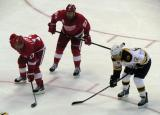 David Legwand, Johan Franzen, and Boston's Jarome Iginla line up for a faceoff.