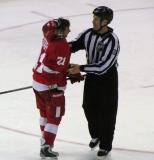 Tomas Tatar is restrained by linesman Mark Shewchyk.