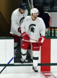 Drew Miller and Corey Tropp step onto the ice for a session at the 2014 MSU Pro Camp.