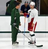 Justin Abdelkader talks to Jason Muzzatti during a session at the 2014 MSU Pro Camp.
